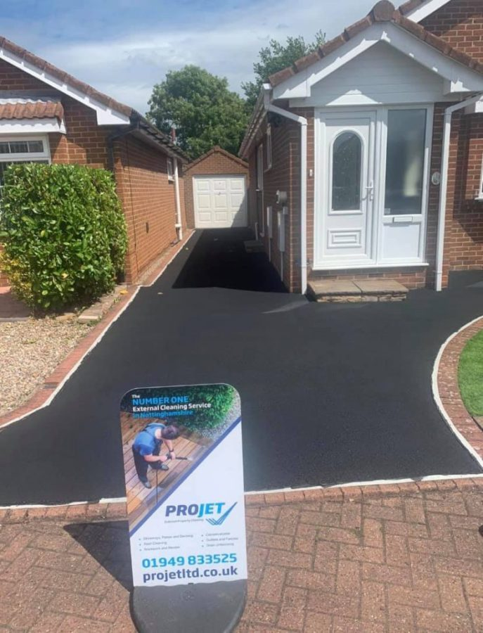 projet sign in front of new clean driveway